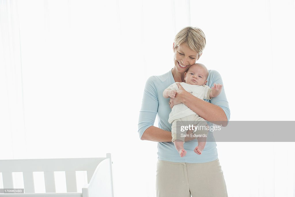 Woman holding newborn baby : Stock Photo