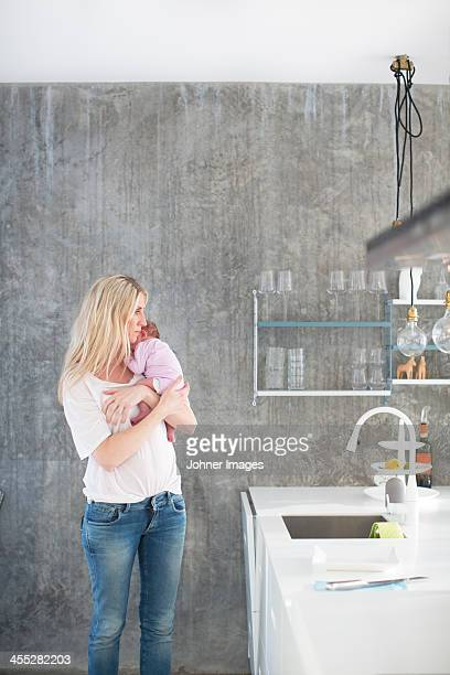 Woman holding newborn daughter