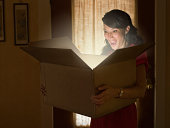 Woman holding box with light illuminating out