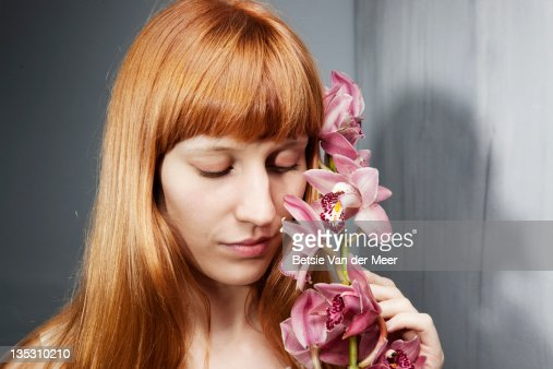Woman holding orchid stem. : Stock Photo
