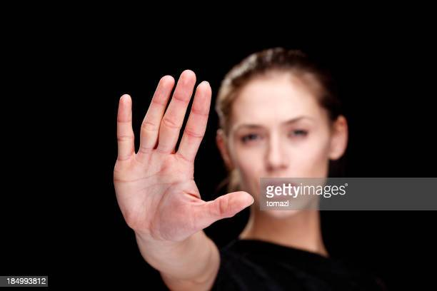 Woman holding out her hand to signify 'Stop '
