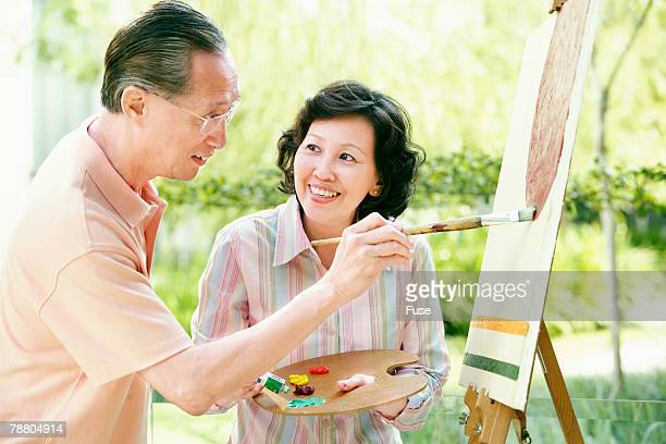 Woman Holding Paints For Her Husband