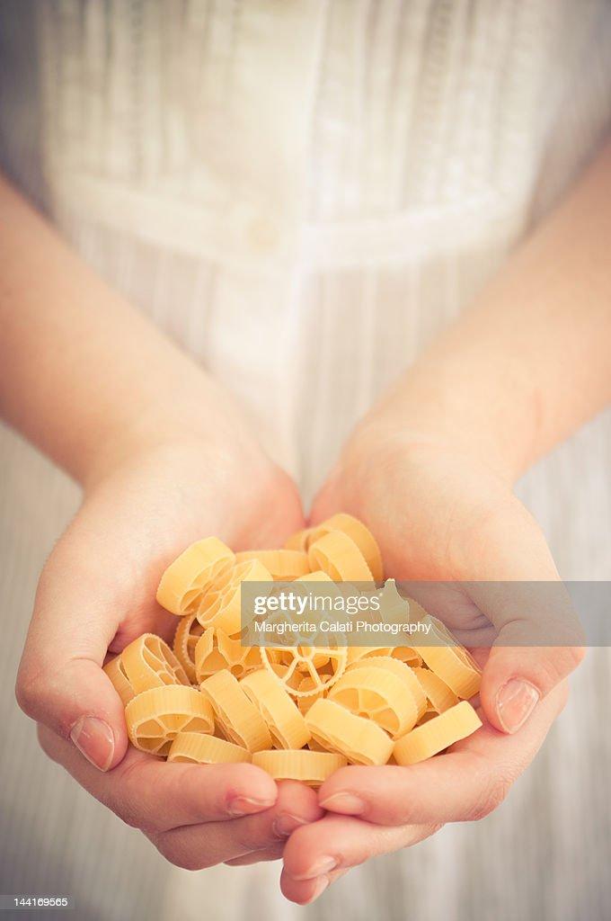 Woman holding pasta : Stock Photo