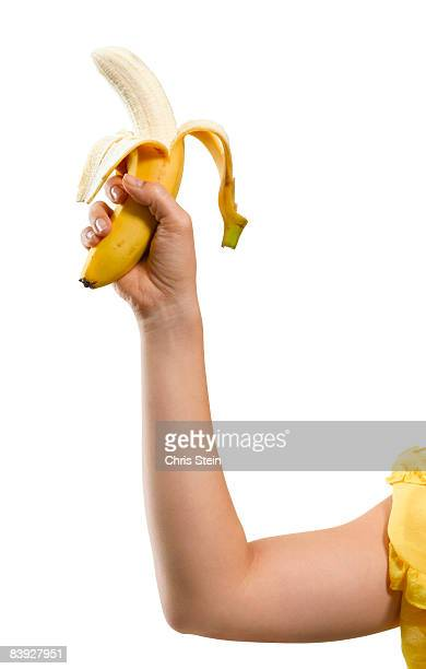 Woman holding peeled banana