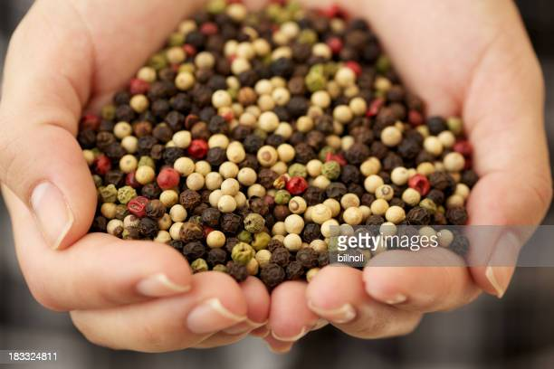 Woman holding peppercorns