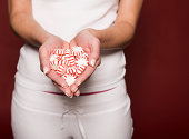 Woman holding peppermint candies