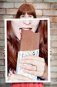 woman holding picture of chocolate