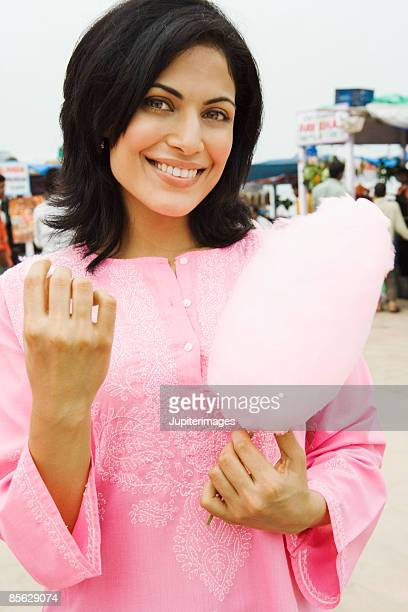 Woman holding pink cotton candy