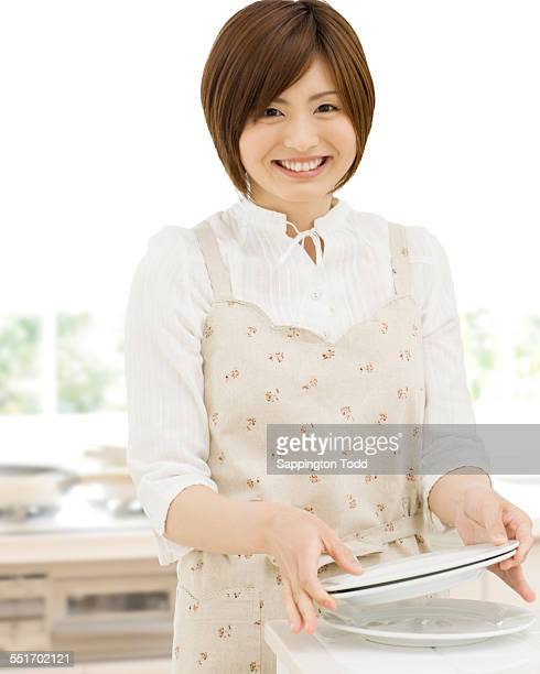Woman Holding Plates