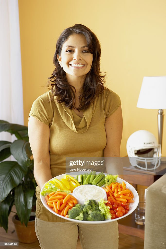Woman holding platter of vegetables : Stock Photo