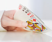 Woman holding playing cards, close-up
