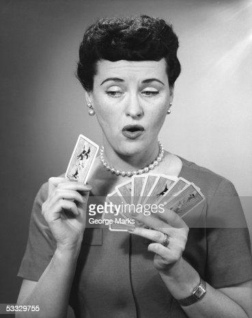 Woman holding playing cards : Bildbanksbilder