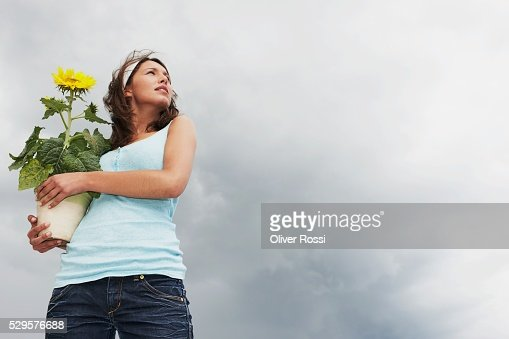 Woman Holding Potted Plant : Stock-Foto