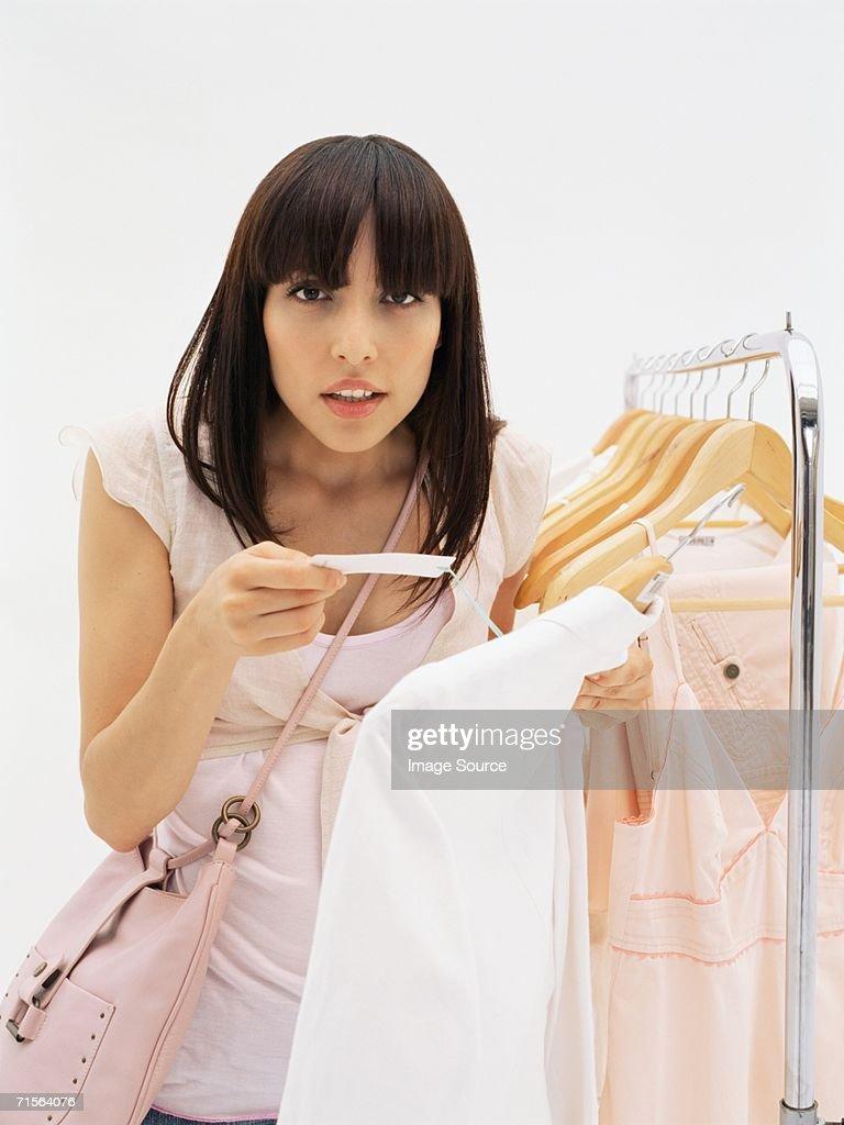 Woman holding price label : Stock Photo