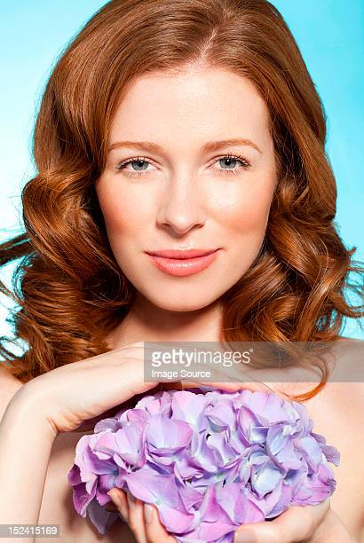 Woman holding purple flowers