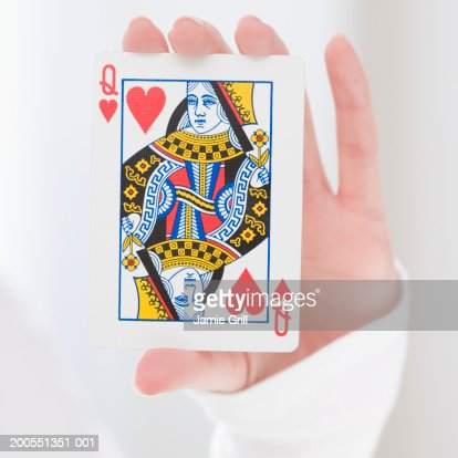 Woman holding queen card, close-up