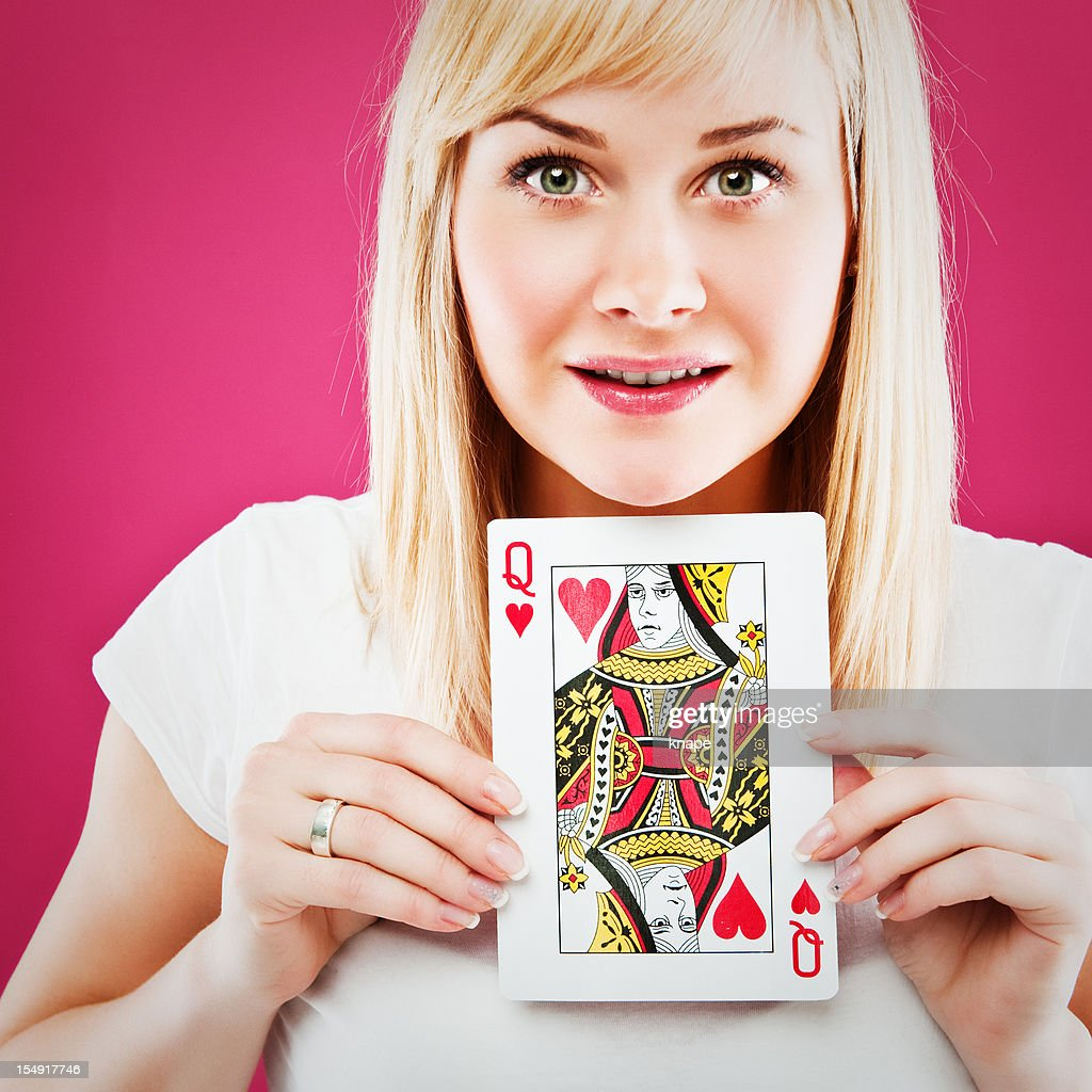 woman holding queen of hearts