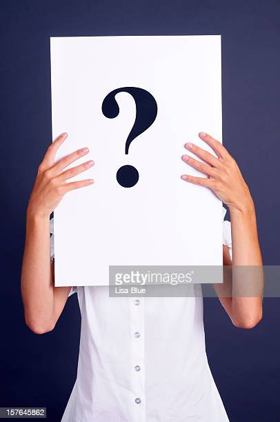 Woman Holding Question Mark Paper In Front Of Face