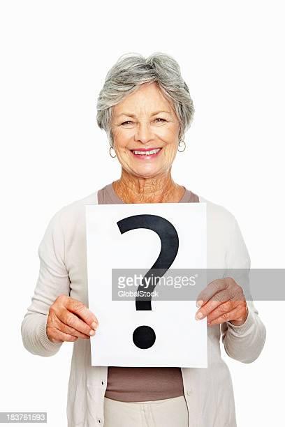 Woman holding question mark sheet