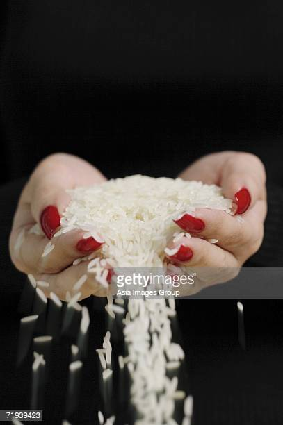 Woman holding rice in cupped hands