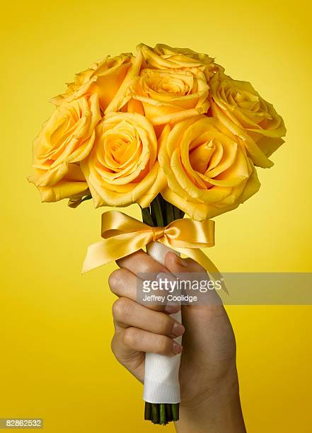 woman holding rose bouquet