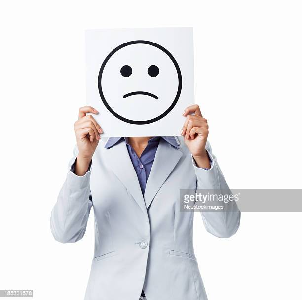 Woman Holding Sad Smiley Sign - Isolated