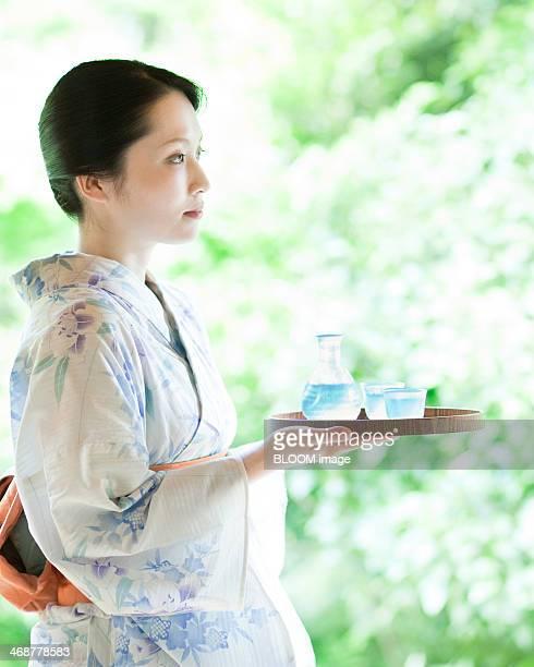 Woman Holding Sake