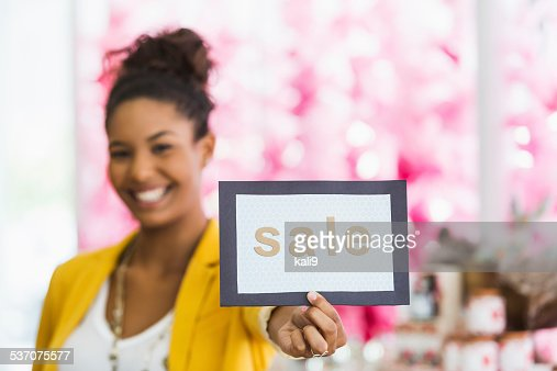 Woman holding SALE sign