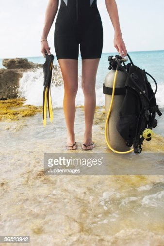 Woman holding scuba diving equipment