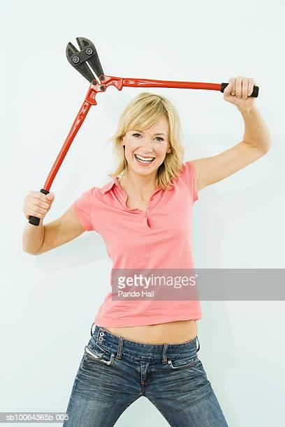 Woman holding secateurs, smiling , portrait