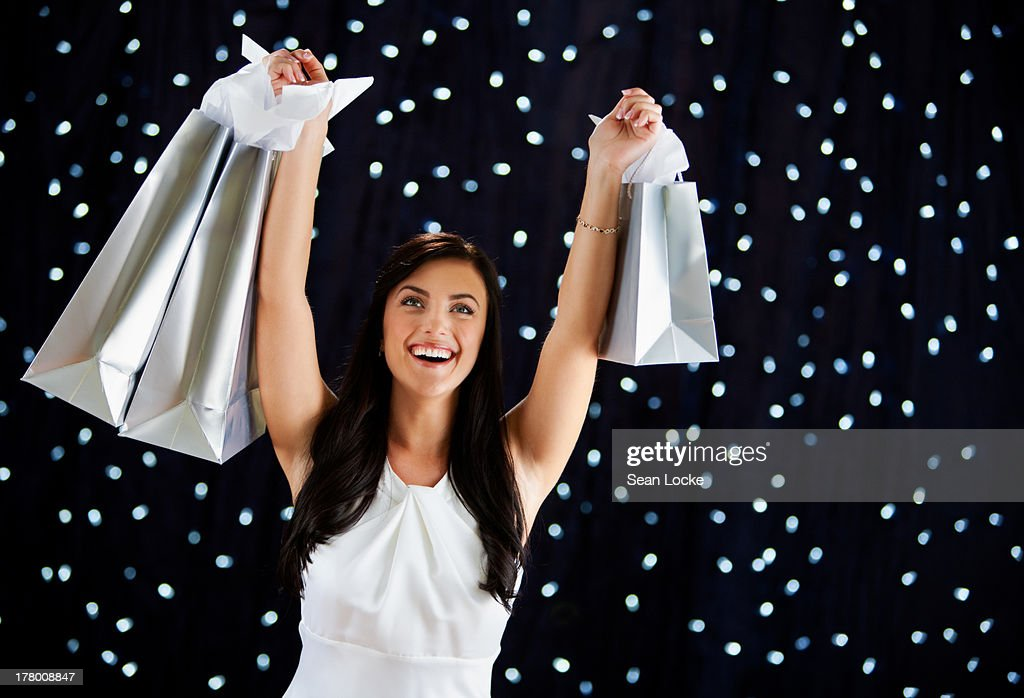 Woman Holding Shopping Bags Aloft : Stock Photo