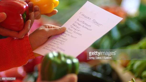 Woman Holding Shopping List