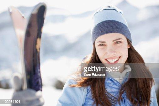 Woman holding skis : Stock Photo