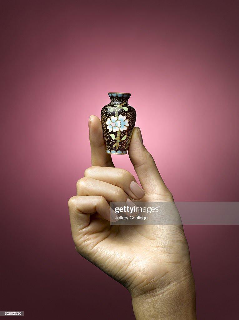 woman holding small vase : Stock Photo