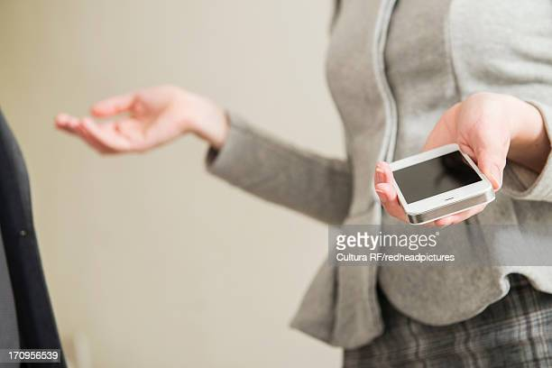 Woman holding smartphone, close up