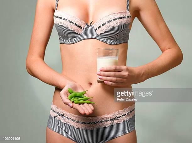 Woman holding soya beans and soya milk