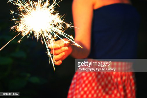 Woman holding sparkler : Stock Photo