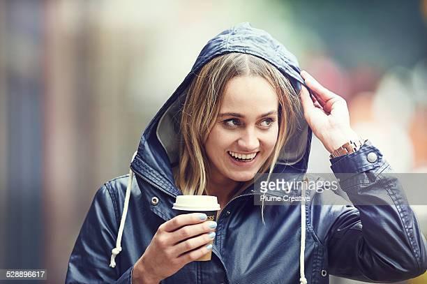 Woman holding take away coffee