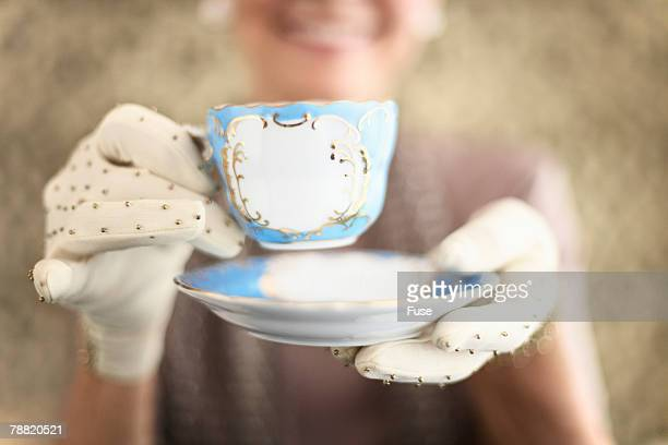 Woman Holding Tea Cup