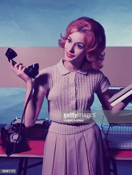 Woman holding telephone receiver