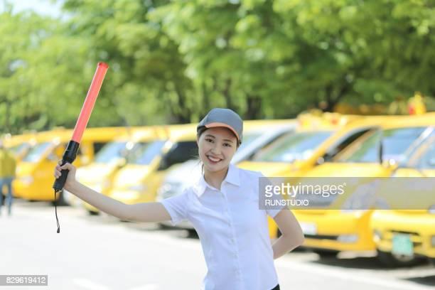 Woman holding traffic rod