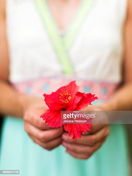 Woman holding tropical flower