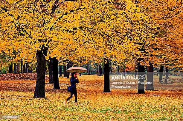 Woman holding umbrella and walking
