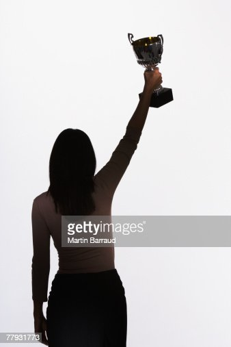 Woman holding up a trophy : Stock Photo