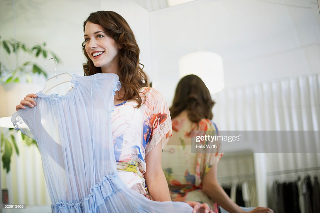 Woman holding up dress : Stock Photo