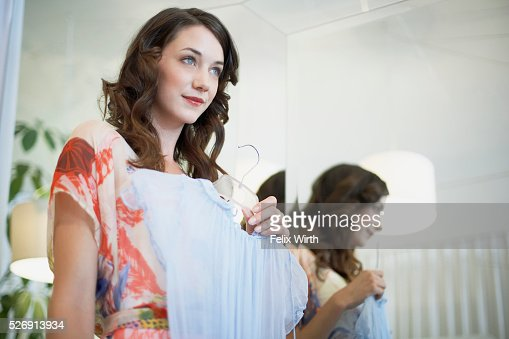 Woman holding up dress : Stockfoto