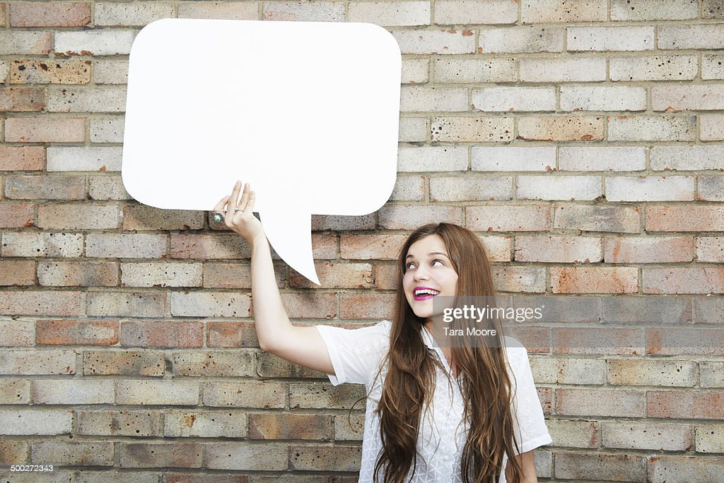 woman holding up speech bubble
