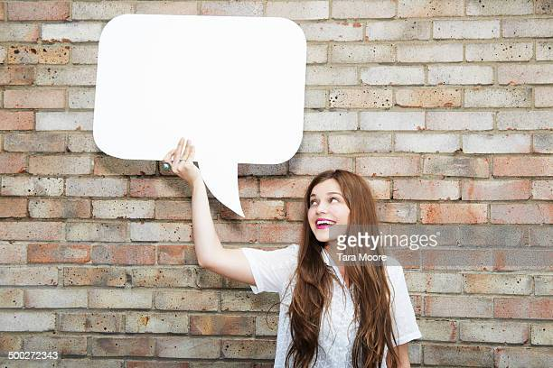 woman holding up speech bubble