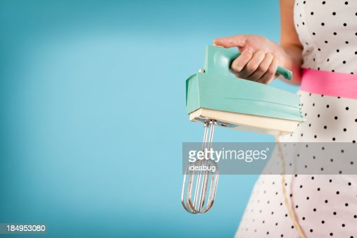 Woman holding vintage electric mixer