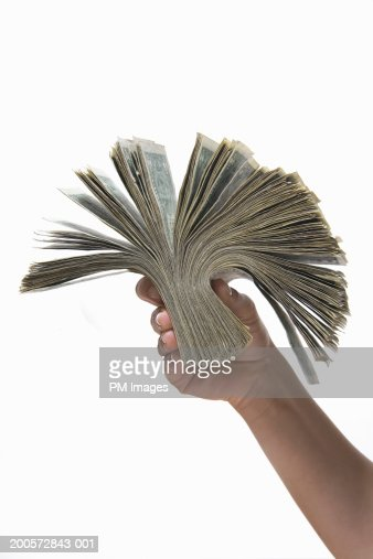 Woman holding wad of US dollar banknotes, close-up : Stock Photo